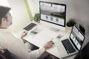 man working with devices web design